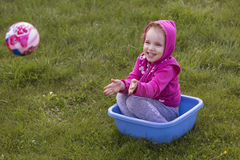 Little girl kid playing, having fun. outdoors Stock Photography