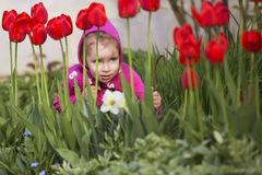 Little girl kid playing, having fun. outdoors Royalty Free Stock Image