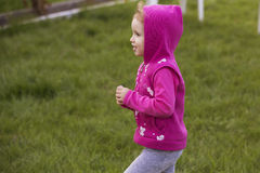 Little girl kid playing, having fun. outdoors Stock Photo