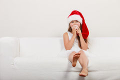 Little girl kid in santa claus hat. Christmas. Stock Photography