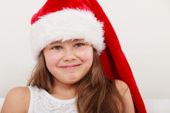 Little girl kid in santa claus hat. Christmas. Stock Image