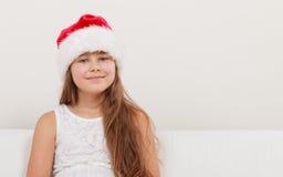 Little girl kid in santa claus hat. Christmas. Stock Photos