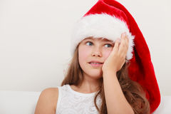 Little girl kid in santa claus hat. Christmas. Royalty Free Stock Photo