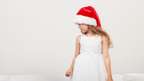 Little girl kid in santa claus hat. Christmas. Royalty Free Stock Images