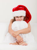 Little girl kid in santa claus hat. Christmas. Royalty Free Stock Photos