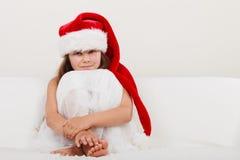 Little girl kid in santa claus hat. Christmas. Stock Photo