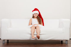 Little girl kid in santa claus hat. Christmas. Royalty Free Stock Image