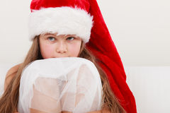 Little girl kid in santa claus hat. Christmas. Stock Images