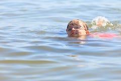 Little girl kid swimming in sea water. Fun Royalty Free Stock Photography