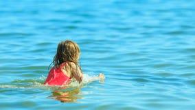 Little girl kid swimming in sea water. Fun Royalty Free Stock Image