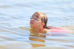 Little girl kid swimming in sea water. Fun Stock Photography