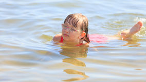 Little girl kid swimming in sea water. Fun Royalty Free Stock Photos