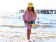 Little girl kid walking on beach at sea. Fun. Royalty Free Stock Image