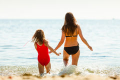 Little girl kid and woman mother in sea water. Fun Royalty Free Stock Photography