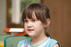 Little girl in the kindergarten Stock Image