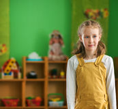 Little girl in kindergarten. Place for your text. Stock Photo
