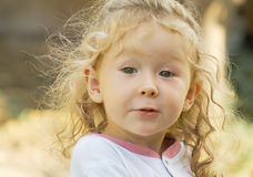 Little girl with kinky hair Stock Photography