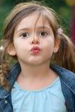 Little girl kiss stock image