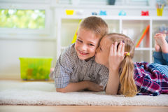 Little girl kiss her happy brother Stock Photo