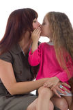 Little girl kiss her mother Stock Photo