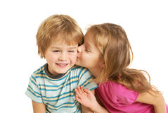Little  girl kiss a little boy Royalty Free Stock Photo