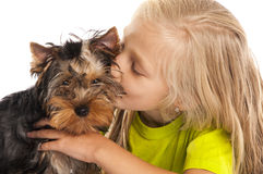 Little girl kisses her dog Royalty Free Stock Photos