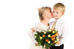 Little girl kissing a boy, formal studio shot Royalty Free Stock Image