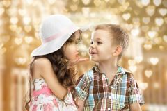 Little girl kissing boy. Girl sends kiss boy on the hearts background Stock Photography