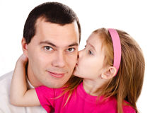 Little girl kissing her father isolated Stock Photography