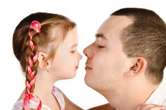Little girl kissing her father isolated Royalty Free Stock Photography