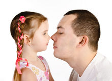 Little girl kissing her father isolated Stock Images