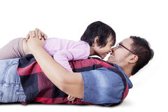 Little girl kissing her father nose Stock Photos