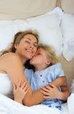 Little girl kissing her mother Stock Image
