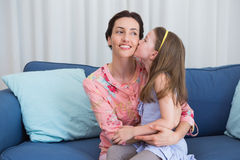 Little girl kissing her mother Royalty Free Stock Image