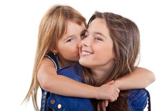 Little girl kissing her sister Stock Photo