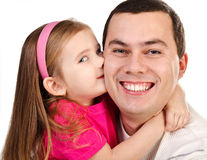 Little girl kissing her smiling father isolated Stock Image