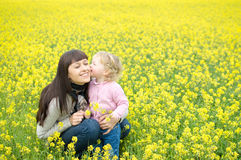 Little girl kissing mother royalty free stock photo