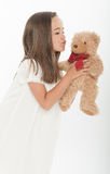 Little girl kissing teddy bear Royalty Free Stock Photo