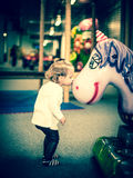 Little girl kissing a unicorn Royalty Free Stock Photos