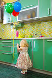 Little girl on kitche Royalty Free Stock Photos