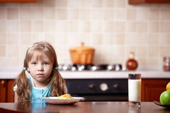 The little girl on kitchen Stock Image
