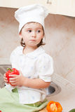Little girl on kitchen Stock Photo