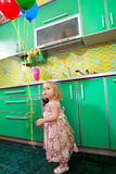 Little girl on kitchen Stock Image