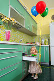 Little girl on kitchen Royalty Free Stock Photos