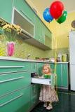 Little girl on kitchen Royalty Free Stock Photos