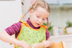 Little girl in the kitchen Stock Image