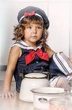 Little girl in the kitchen. Of cookware Royalty Free Stock Photos