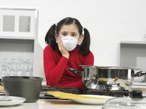 Little girl in the kitchen Royalty Free Stock Photography