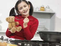 Little girl in the kitchen Royalty Free Stock Image