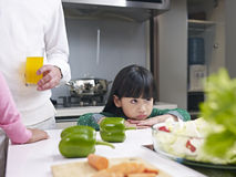 Little girl in kitchen Stock Image
